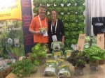 "Pete and Shelley Overgagg at Expo West in Anaheim 3/9/2014 in front of ""The Wall"" of Butter Lettuce and other displayed hydroponic greens."